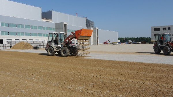 Pala de distribución de arena